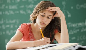 Lehi, Utah, USA --- Caucasian teenager studying in classroom --- Image by © Mike Kemp/Blend Images/Corbis